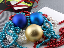 Christmas ball and pearls on a plate, new year card Royalty Free Stock Photo
