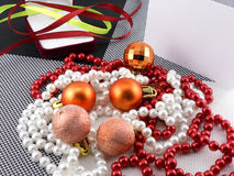Christmas ball and pearls on a plate, new year holiday Royalty Free Stock Image