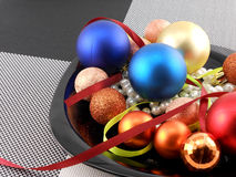 Christmas ball and pearls on a plate, new year holiday Stock Photo