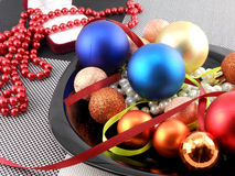 Christmas ball and pearls on a plate, new year holiday Stock Photos