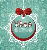 Christmas ball with penguins Stock Image