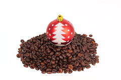 Christmas ball on a pile of coffee beans Royalty Free Stock Photo