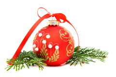 Christmas ball and a pine branch. Royalty Free Stock Photo