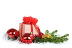 Christmas ball with pine branch and gifts Stock Photography