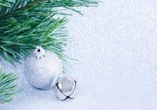 Christmas ball with pine branch. Stock Image