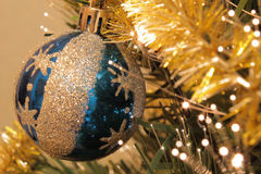 Christmas ball on the pinetree. Royalty Free Stock Photo