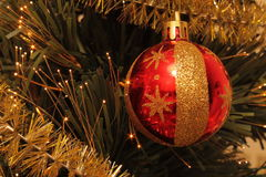 Christmas ball on the pinetree. Royalty Free Stock Photos