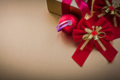 Christmas ball present box with tied ribbon bows Royalty Free Stock Photos