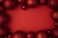 Christmas ball on red background Flat lay. Christmas winter decoration Xmas holiday. New Year background top view with copy space royalty free stock image