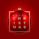 Christmas Ball on Red Background with Golden Modern Typography Greetings in a Frame. Classy Card or Poster Royalty Free Stock Photos
