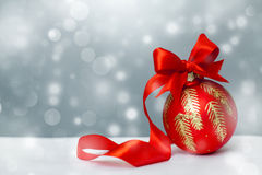 Christmas ball with red bow and ribbon Royalty Free Stock Images