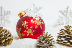 Christmas ball with red bow and ribbon Royalty Free Stock Photo