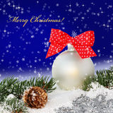 Christmas ball with red bow in the snow Stock Image