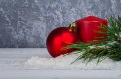 Christmas ball with red candle and pine branch Stock Photos