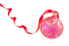 Christmas ball with a red ribbon Stock Images