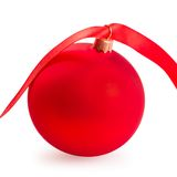 Christmas ball with a red ribbon Royalty Free Stock Images
