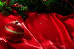 Christmas ball on red satin. Red christmas ball on red satin Royalty Free Stock Image