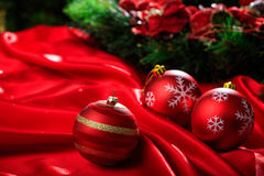 Christmas ball on red satin. Red christmas ball on red satin Royalty Free Stock Photo