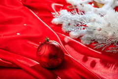 Christmas ball on red satin. Red christmas ball on red satin Royalty Free Stock Images