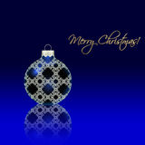 Christmas ball with reflection on blue Royalty Free Stock Images