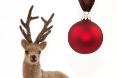 Christmas ball with reindeer. Red Christmas ball with a reindeer and a white background Stock Photo