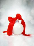 Christmas ball with ribbon. On silver background Royalty Free Stock Images