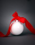 Christmas ball with ribbon. On dark grey background Stock Images