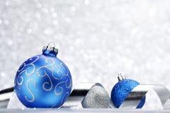 Christmas ball and ribbon Stock Image