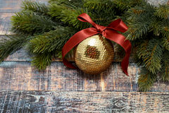 Christmas ball with ribbon and pine branches Stock Photo