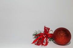 Christmas ball with ribbon and tree branch Royalty Free Stock Photography