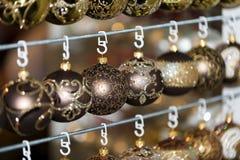 Christmas ball in a row, selective focus. Christmas decorative balls in a row stock image