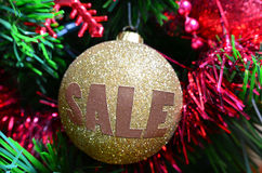 Christmas ball - sale. Golden Christmas ball with sale written on it Royalty Free Stock Images