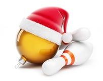 Christmas ball in santa hat Bowling santa hat Stock Images
