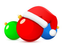 Christmas ball and Santa hat Royalty Free Stock Photography
