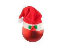 Christmas ball with Santa hat on white. Stock Photos