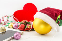 Christmas ball with Santa's hat and earphones Stock Photo
