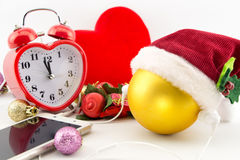 Christmas ball with Santa's hat and earphones Stock Image