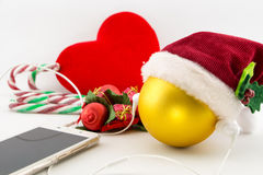 Christmas ball with Santa's hat and earphones Stock Images