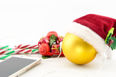 Christmas ball with Santa's hat and earphones Stock Photography
