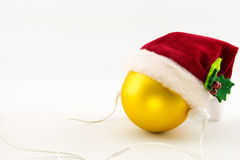 Christmas ball with Santa's hat and earphones Stock Photos