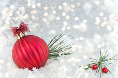 Christmas ball on shiny silver background. Red Christmas ball on shiny silver background stock image