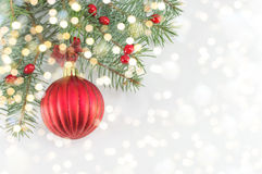 Christmas ball on shiny silver background. Red Christmas ball on shiny silver background royalty free stock images