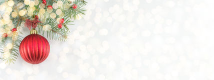 Christmas ball on shiny silver background. Red Christmas ball on shiny silver background wide banner stock images
