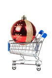 Christmas ball in the shopping cart isolated on white Royalty Free Stock Image