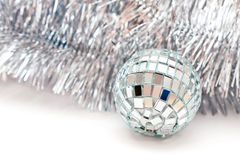 Christmas ball and a silver garland Stock Images