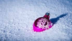 Christmas ball in the snow Stock Photography