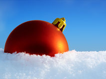 Christmas ball in snow Royalty Free Stock Images
