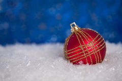 Christmas ball in snow Stock Photo