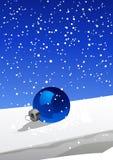 Christmas ball on the snow Stock Image