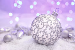 Christmas ball  in the snow on abstract background Royalty Free Stock Photos